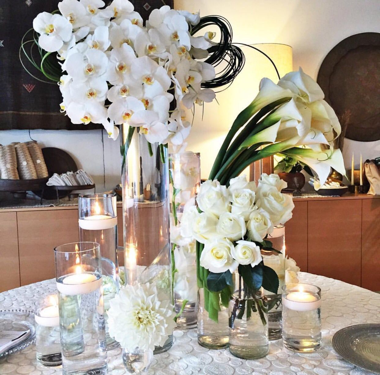 Flowers w/clear vases. 10 large 100in. clear vase for main ...