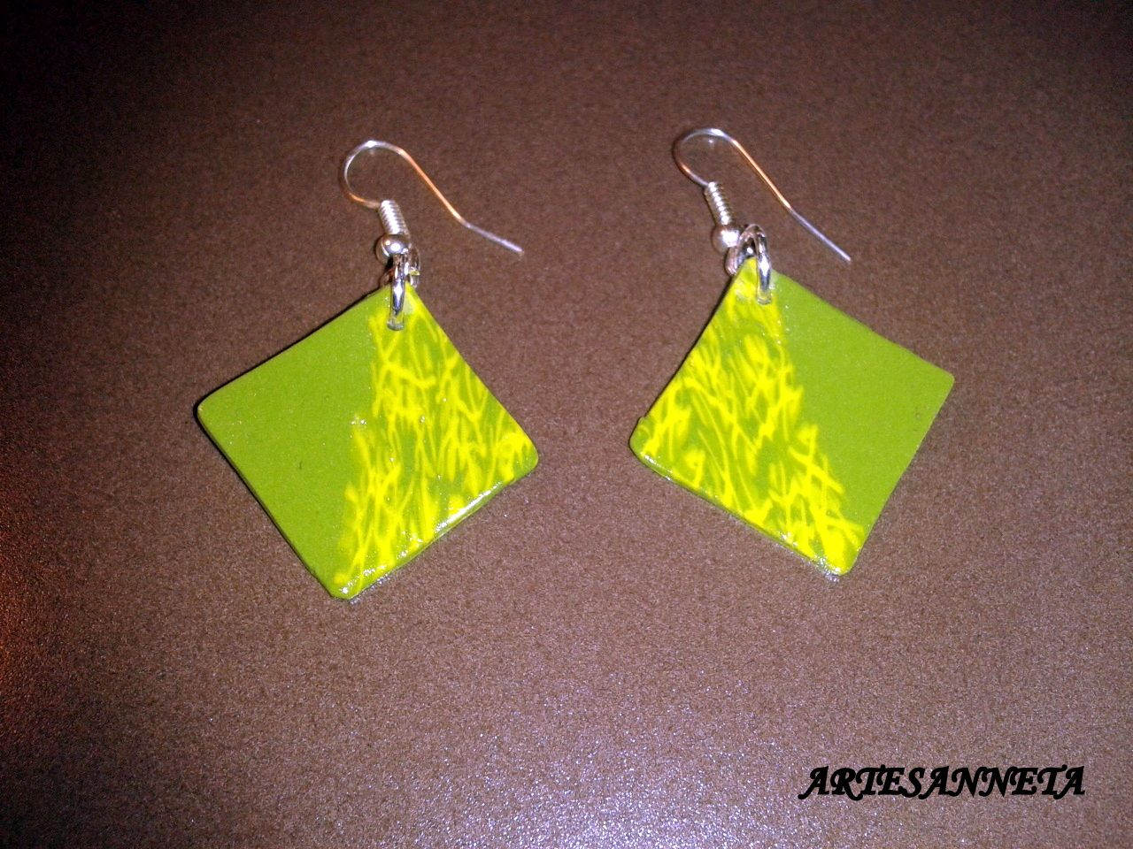 Earrings made of fimo. One half is made of green fimo and the other one is made of a mixture of green and lima.