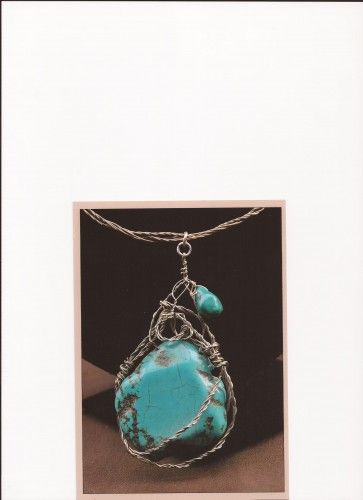 It is about 60 cm long. It is made of entwined silver wires (925gm) forming a thick cord. The turquoise pendant is wire wrapped with entwined silver wires (925 gm). SOLD