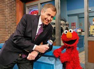 Brian Williams with Elmo