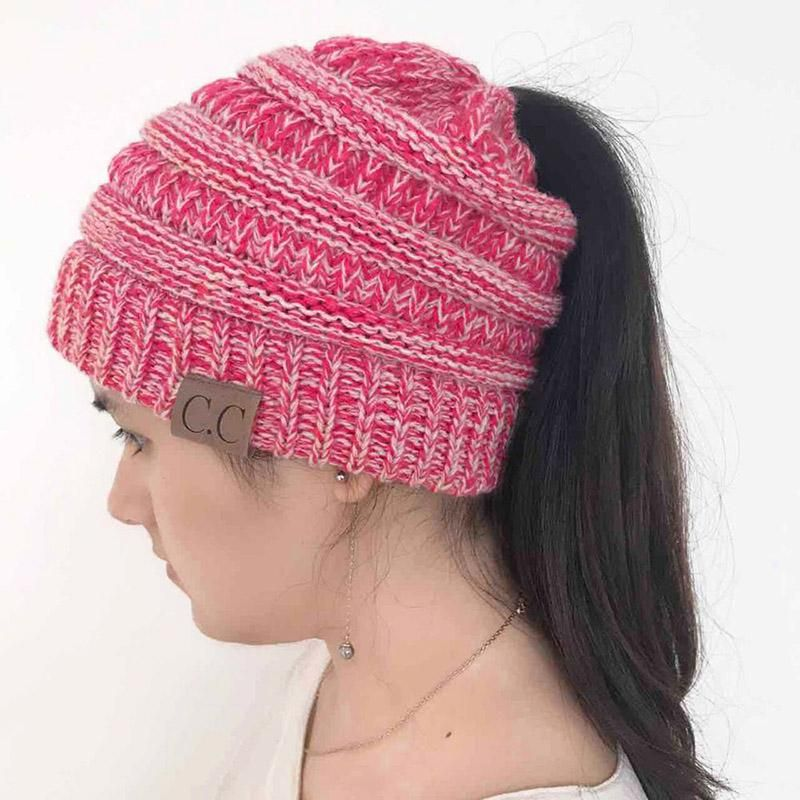 d08db8bb0be LONSUNNOR 2018 New Trendy CC Warm Winter Hat For Women Ponytail Beanie  Stretch Cable Knit Messy Bun Hats Soft Ski Cap Wholesale