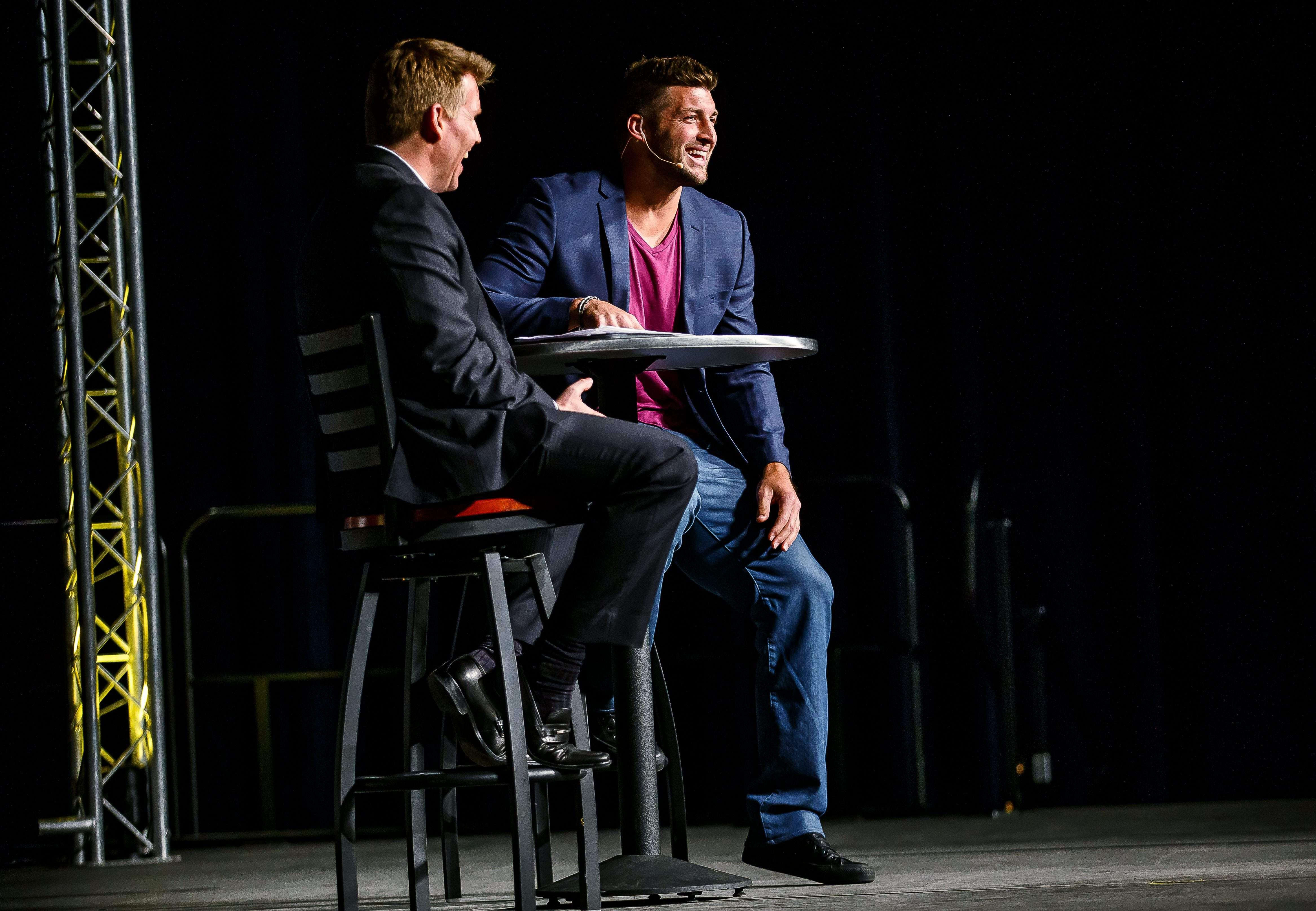NFL Network RedZone Host Scott Hanson, left, talks with Tim Tebow, right, on stage during the Central Illinois 2014 FCA Home Team Banquet at the Prairie Capital Convention Center, Sunday, May 4, 2014, in Springfield, Ill. Justin L. Fowler/The State Journal-Register