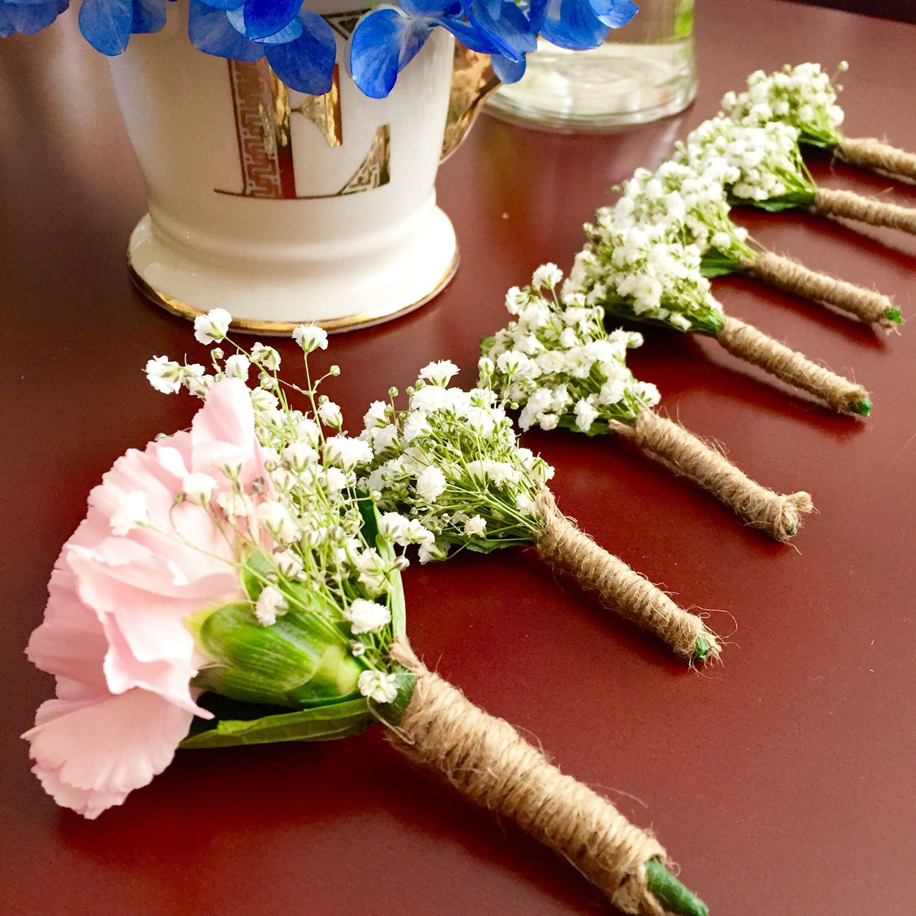 Wedding bouquets not flowers  Babyus breath and carnations boutonniere I do not want it to be