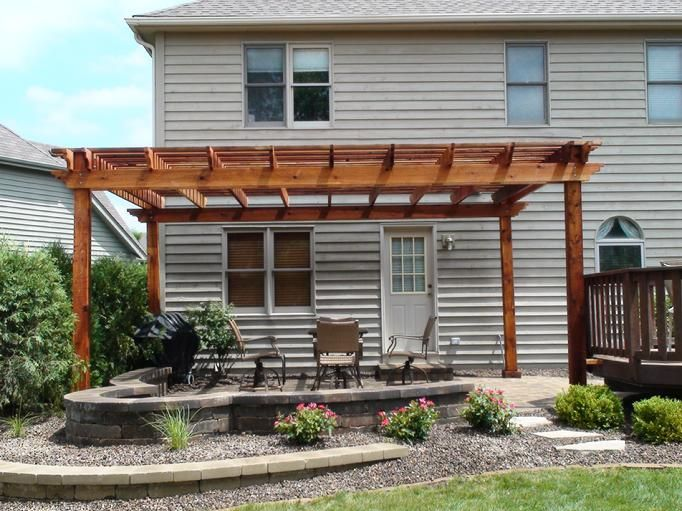 Pergola over patio covers only half of flat back facade for Flat pack garden decking