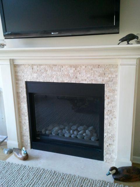 Split-face stone fireplace surround. ocean inspired. makeover ...