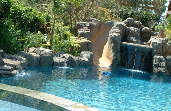 Pools With Slides And Waterfalls Pool Landscaping Pool Water
