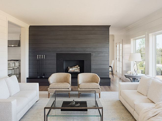 Living room with shiplap wall painted in a charcoal gray color