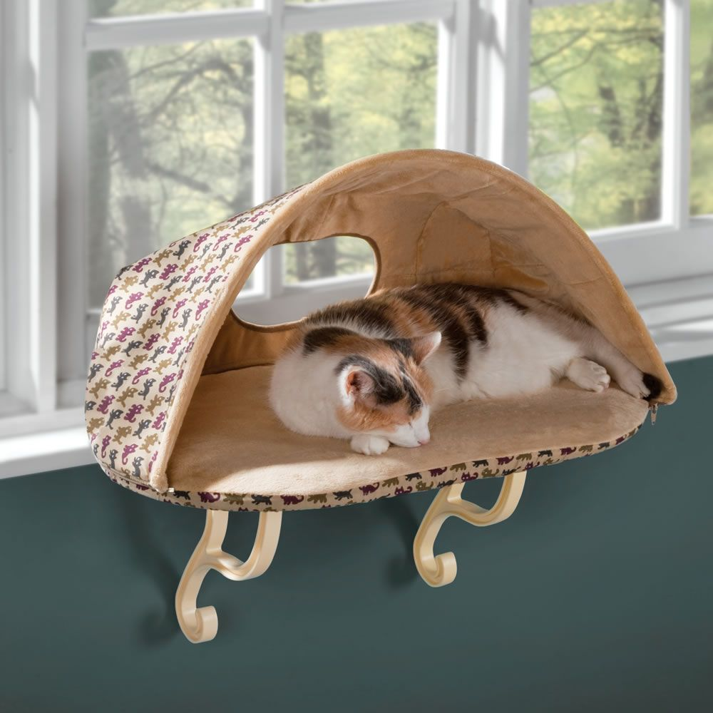 Window bed for cats  the catus warming window seat  hammacher schlemmer  animals