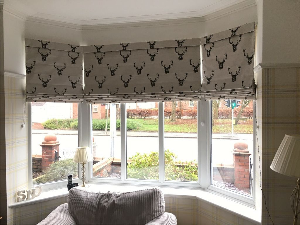 Handmade Pattern Matched Roman Blinds In A Bay Window Roman Blinds Living Room Bay Window Blinds Bay Window Treatments