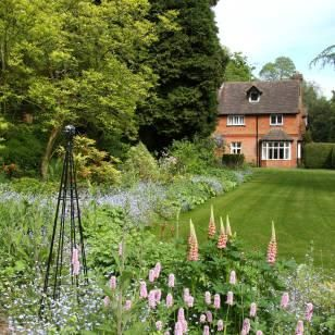 Stunning cottage style planting gives a visual frame to long gardens