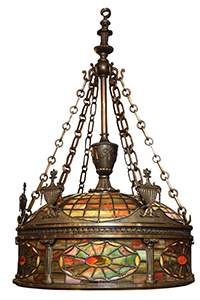 "Tiffany style bronze and stained glass chandelier. CIRCA: 1900's DIMENSIONS: 37"" h x 24.5"" d"