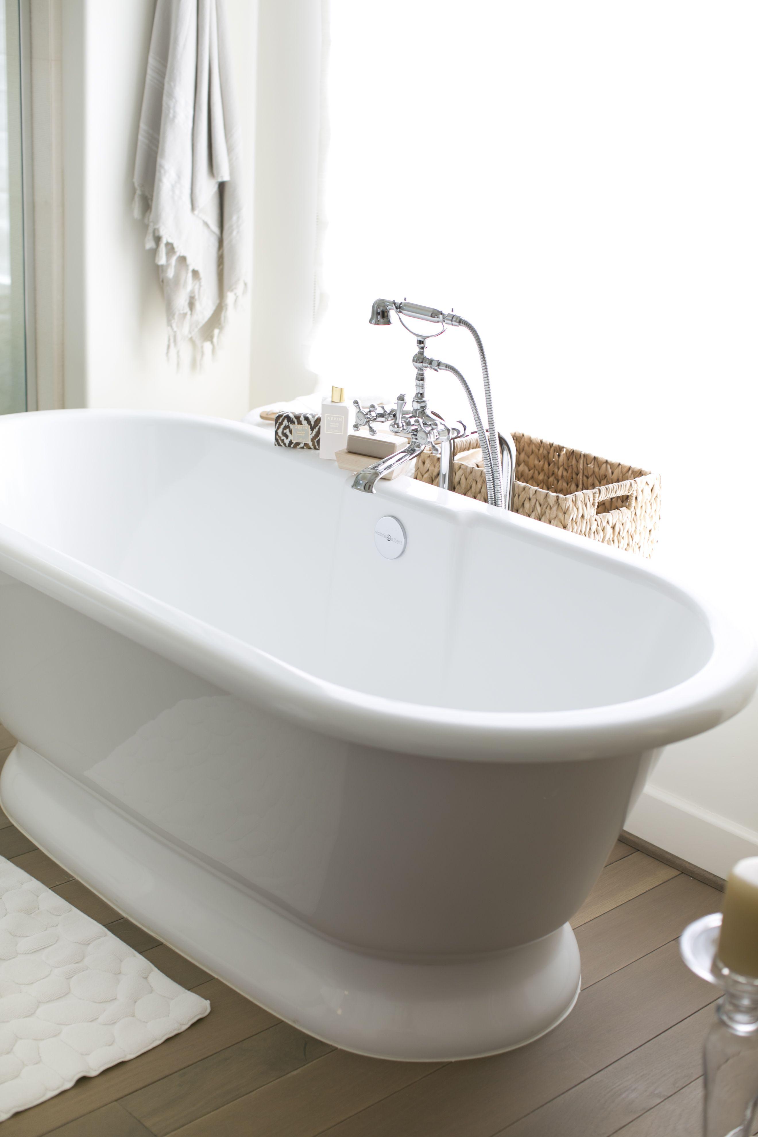Bath remodel White tub silver tap