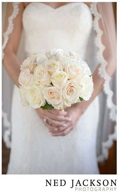 Classic rose bouquet with the bride's grandmother's rosary beads intertwined.  www.jerifloraldesign.com  photo by www.nedjackson.com