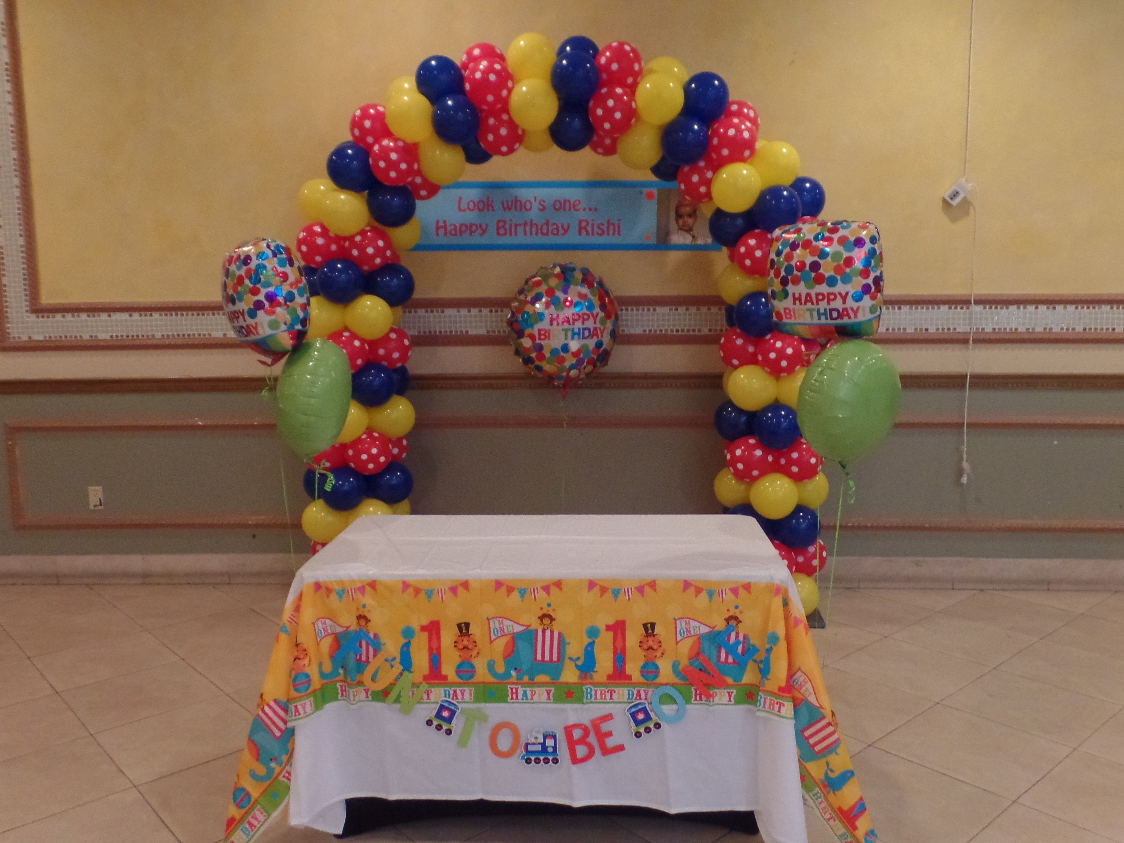 Carnival theme balloon arch using dark blue red polka dot and