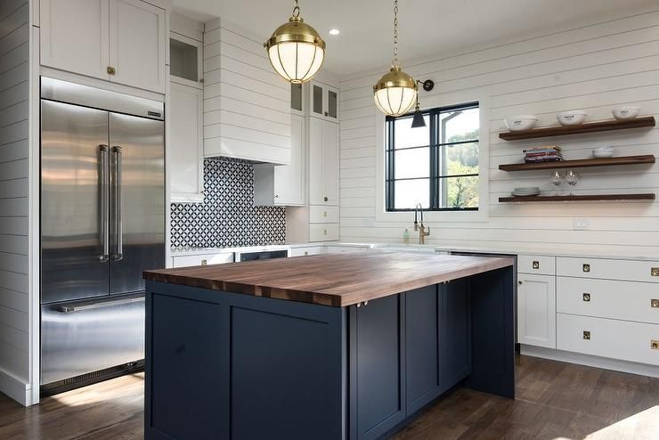 A Dark Blue Island With A Walnut Countertop Stands Out Amongst White Shaker Perimete Cheap Kitchen Remodel Kitchen Remodel Countertops Farmhouse Kitchen Design