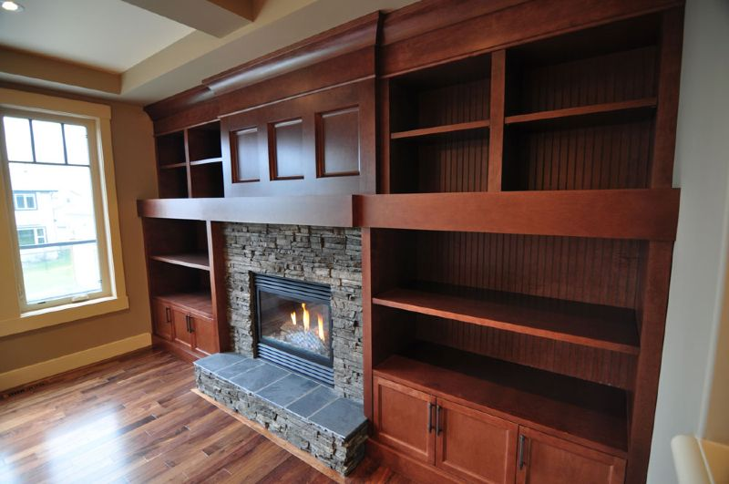 Custom built-in wall unit with feature fireplace. Unit contains ...
