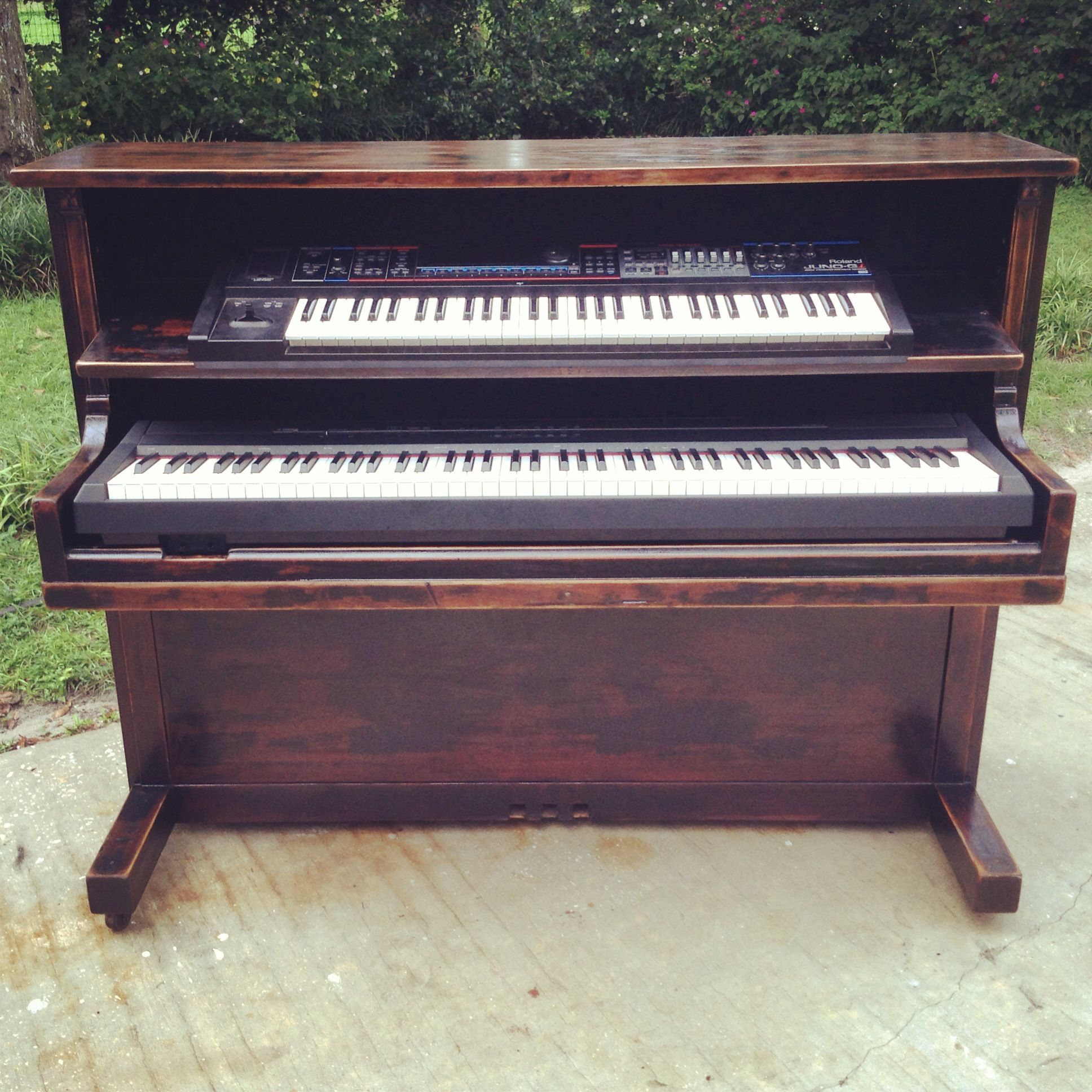 A Keyboard Stand Made Out Of Old Upright Piano
