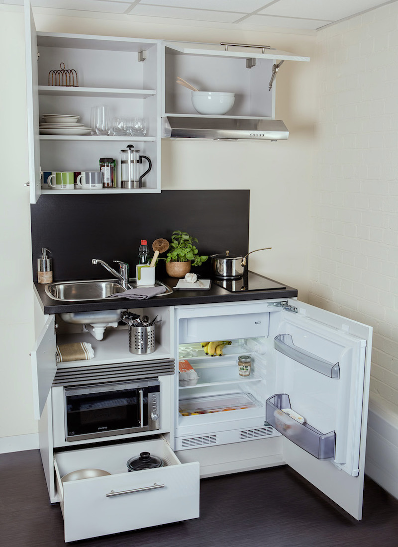 16 Tiny Kitchens That Prove That Bigger Isn T Always Better Tiny Kitchen Design Small Apartment Kitchen Tiny House Kitchen