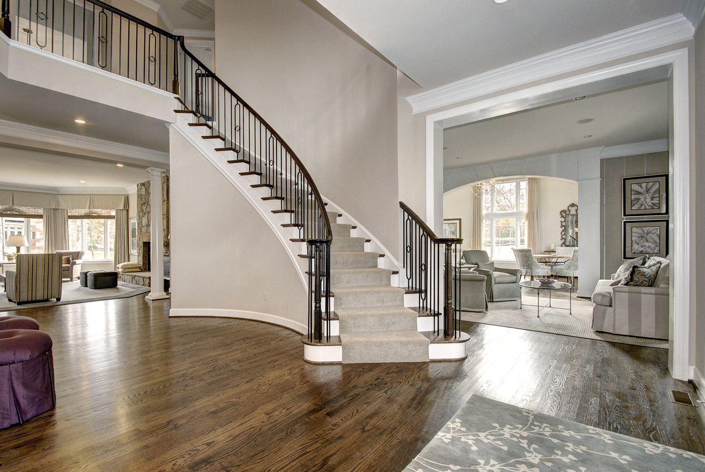 Home Group Foyer : Foyer with curved staircase and views into the home