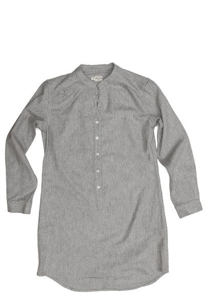 Long-sleeve shirtdress with short collar and gathered shoulder detail. Button cuff and placket. 60% wool, 35% viscose.