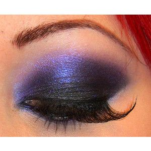 purple and black smokey eye with false lashes makeup look
