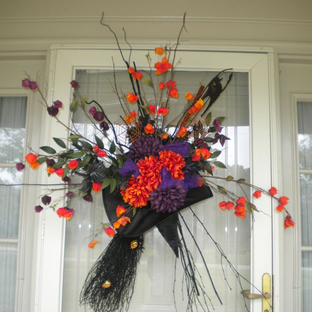 Halloween Arrangement That My Cousin Made With Flowers A Witches Hat And Broom And A Great Imagination Halloween Floral Halloween Brooms Halloween Decorations