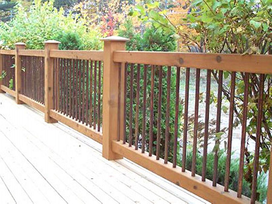 Cedar deck railing with iron view more deck railing ideas for Balcony handrail