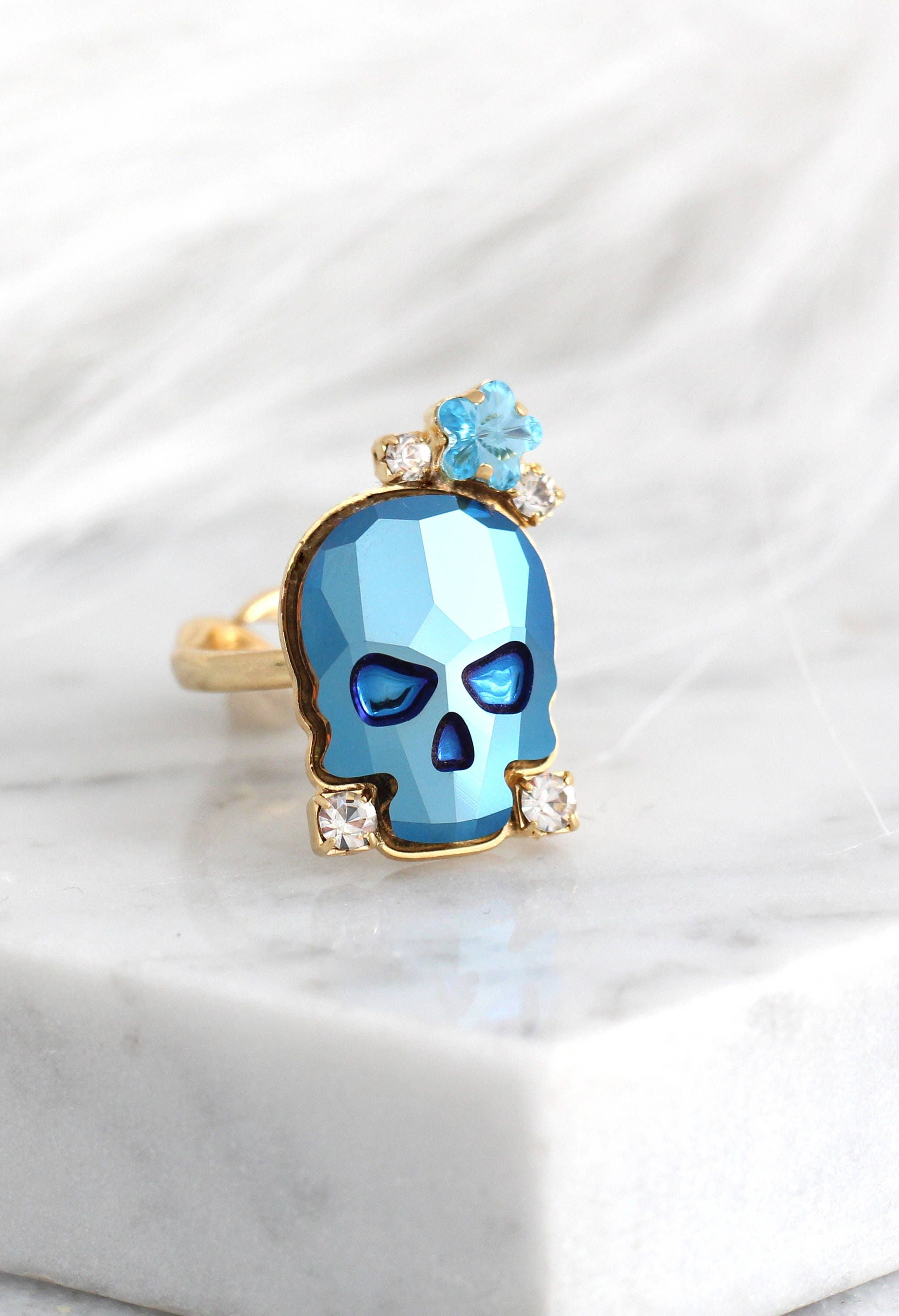 """""""Skull Ring, Sugar Skull Ring, Cocktail Ring, Gothic Ring, Boho Chic Ring, Blue Ring, Adjustable Skull Crystal Ring, Gift For Woman. ♥IF YOU WANT THE BEST CHOSE THE ORIGINAL ♥ Top Quality Materials ♥ Excellent Customer Service ♥ Handcrafted with genuine crystals ♥ IF YOU WANT THE BEST CHOSE THE ORIGINAL Arrives in our signature Petite Delights by Ilona Rubin® Box. Sent By Registered Insured mail. Details : ♥ U.S packages shipped via USPS® insured+USPS® tracking number ♥ Handcrafted with genuine"""