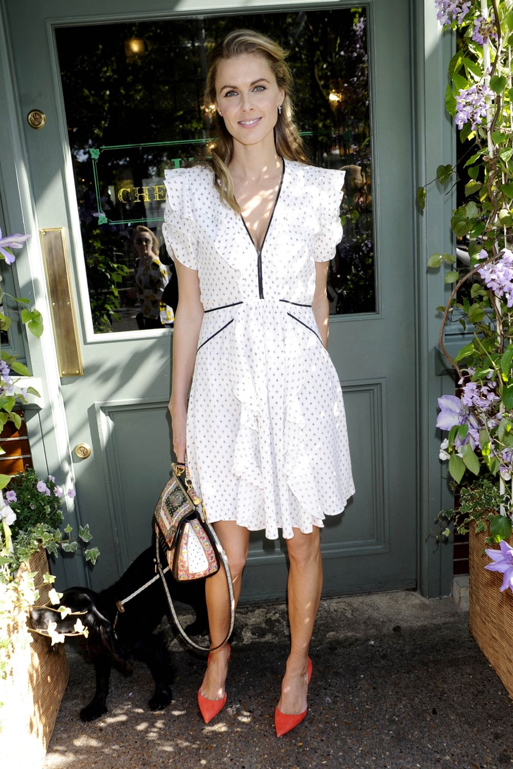 1141d96d9c Donna Air accessorised her summery tea dress with orange pumps and a Dolce    Gabbana bag for the Jimmy Choo tea party in London