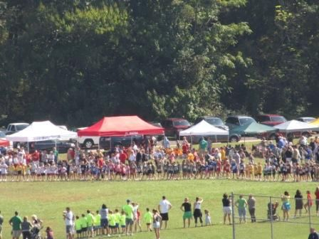 Cross Country Running event show a multitude of school colors on uniforms and tents & Cross Country Running event show a multitude of school colors on ...