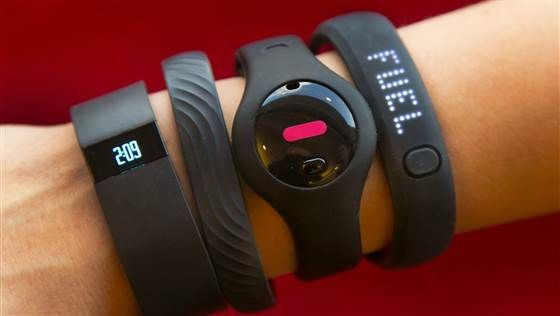 Four fitness trackers are shown in this photograph, in New York,  Monday, Dec. 16, 2013. They are, from left, Fitbit Force, Jawbone Up, Fitbug Orb, a...