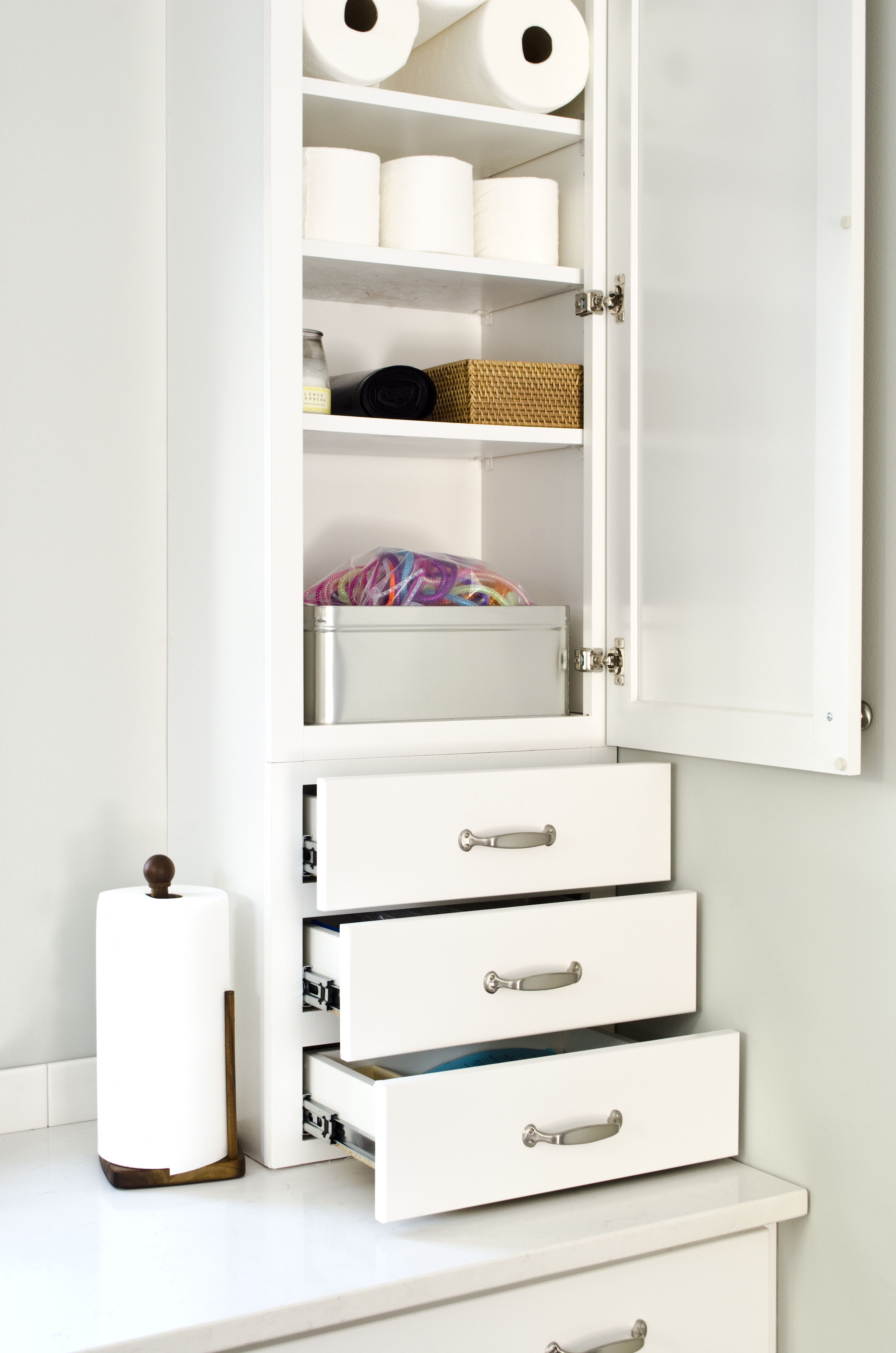 This drawer stack and wall cabinet combination by aristokraft cabinetry provides loads of for Bathroom cabinet with drawers