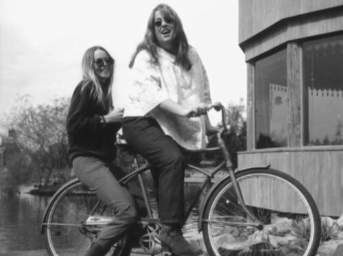 Michelle Phillips and Mama Cass of the Mama's  the Papa's out biking and California Dreamin'