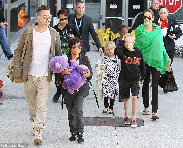 They have a lot of kids: The Pitts with Maddox, Pax, Vivienne, Zahara and Shiloh in Februa...