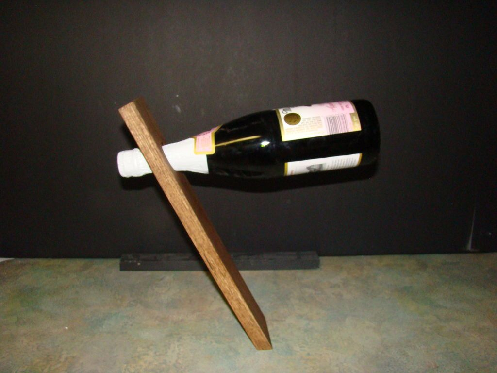 59a3fcca3d How to Make a Floating Wine Bottle Holder--craftsman & scientist in one. :)
