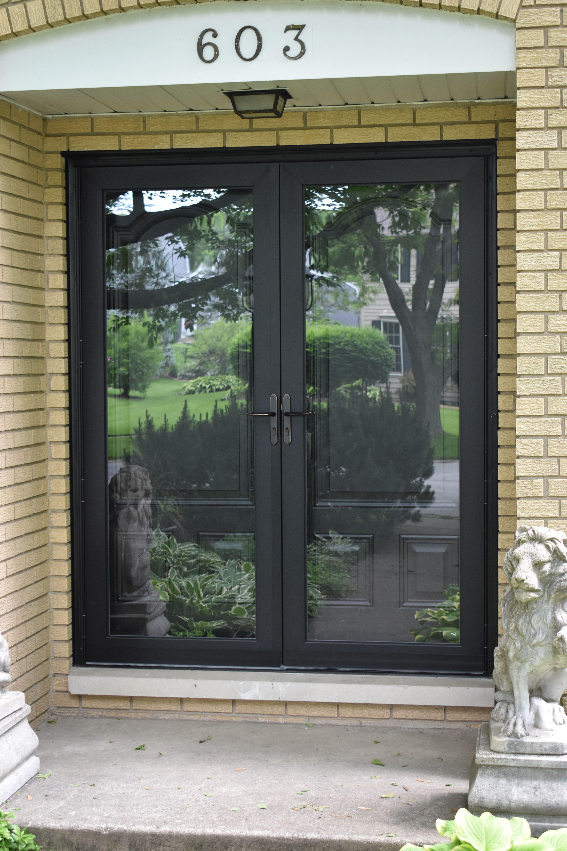 Notitle Full View Storm Door With Retractable Screenfull View Storm Door With Retractable Screenl In 2020 Double Storm Doors Storm Door Brick House Front Door Colors