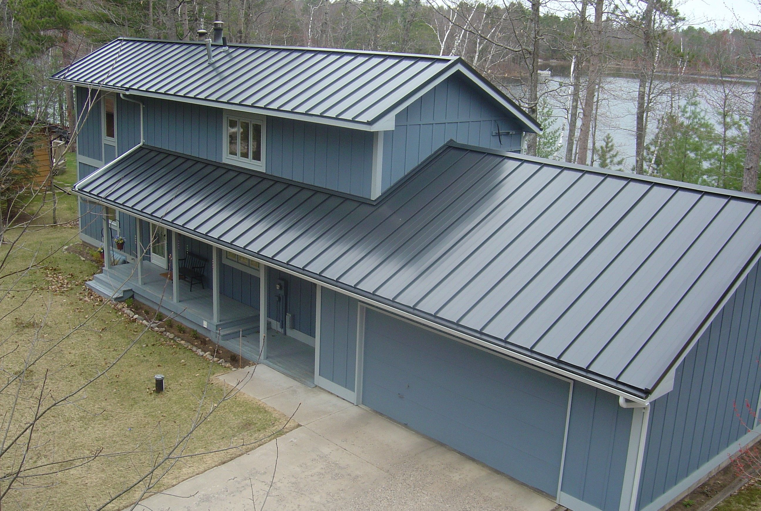 Standing Seam Metal Roof In Slate Gray Metal Provided By Coated Metals Group Www Cmgmetals Com Project Completed By Metal Roof Houses Metal Roof Roof Design