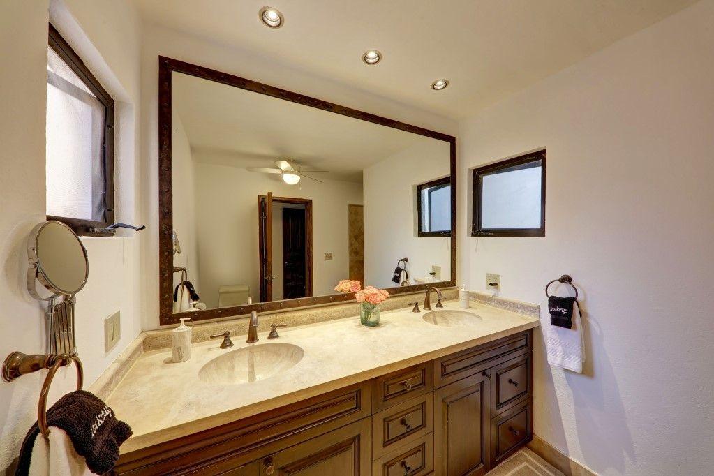 master bedroom bathroom has dual sinks and bright vanity