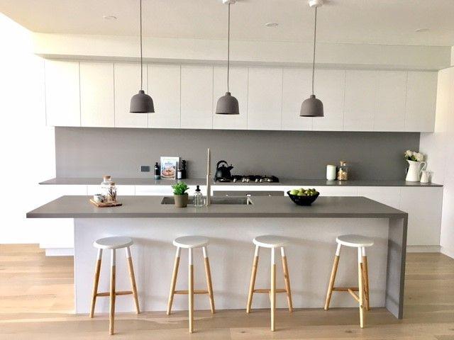 polyuretane kitchen with concrete stone benchtops splashback