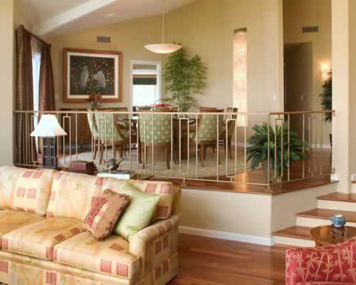 Raised dining room with a bannister. | Sunken living room ...
