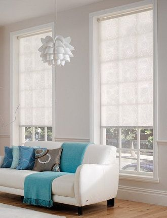 relaxing living room with our modern roller shades in calming white