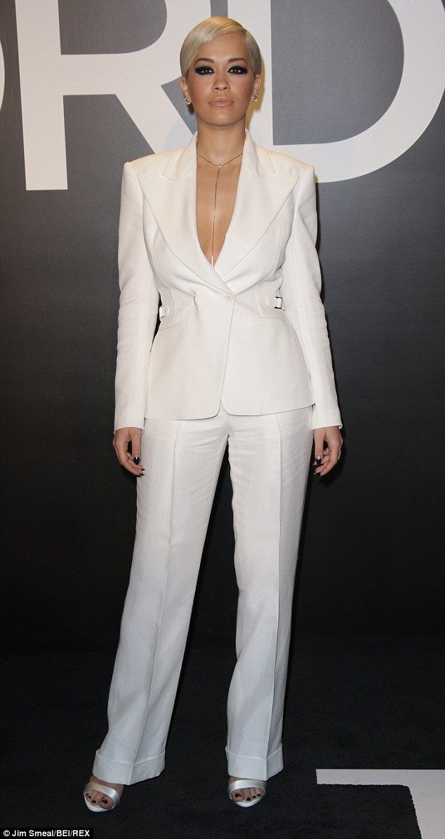 d88f25072069ec Rita Ora shows off serious cleavage in low-cut suit at Tom Ford show    Black   White Pants   Rita ora, Oras, Suits