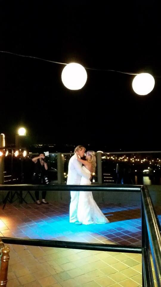 1st dance overlooking the harbor with white lanterns overhead