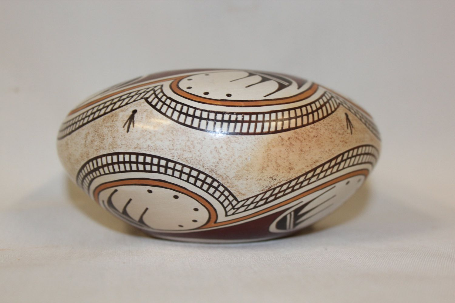 "Hopi 182. Description: Ca. 1980's, Beautiful contemporary poly chrome seed pot with Nampeyo influence, avian patterns. Very good condition. 2-3/4"" x 5-1/2"" Tyra is the daughter of well-known Hopi arti"