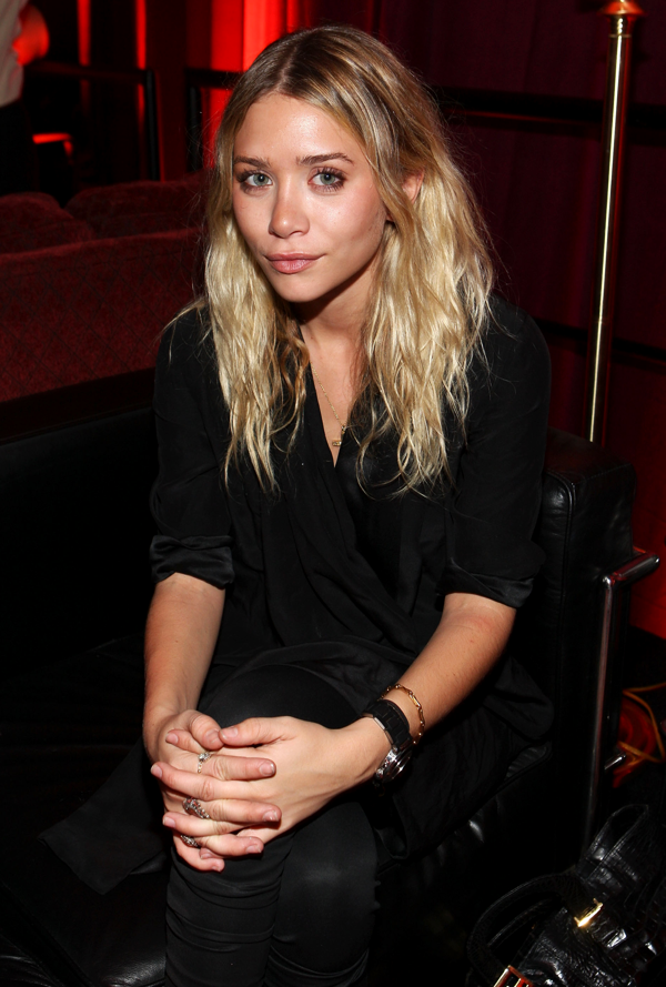 OLSENS ANONYMOUS ASHLEY OLSEN FASHION STYLE BLOG BLACK WRAP TOP SKINNY LEGGINGS BLACK SILVER WATCH VINTAGE CROC FENDI BAG RINGS CHARM NECKLACE GOLD BRACELET HAIR SMIRK SMILE