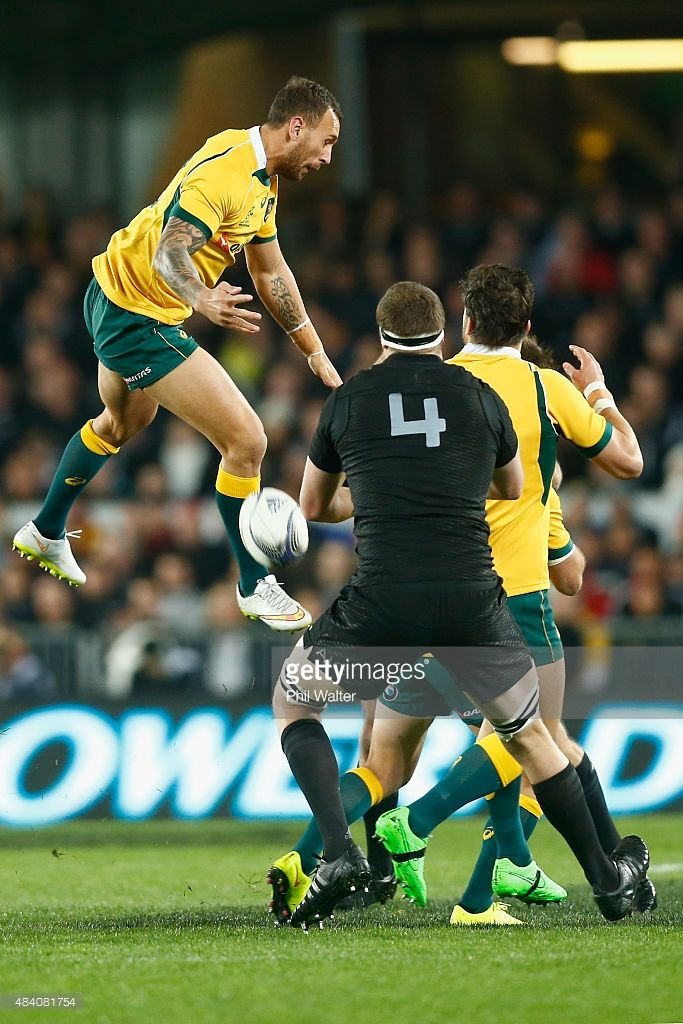 Quade Cooper of the Wallabies attempts to collect the high