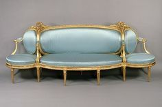 Sofa (canapé à confidents) Maker: Claude I Sené (1724–1792, master 1743) Date: ca. 1775–80 Culture: French Medium: Carved and gilded beechwood upholstered in modern blue dotted silk