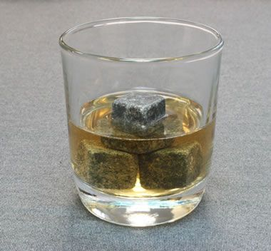 whiskystones-Whiskystones are small soapstone cubes that are refrigerated and then used to chill a glass of whisky. They do not melt and dilute the drink. Since soapstone has a very high specific heat capacity and changes temperature very slowly, a few whiskeystones can keep a drink cold for 30 minutes or more.