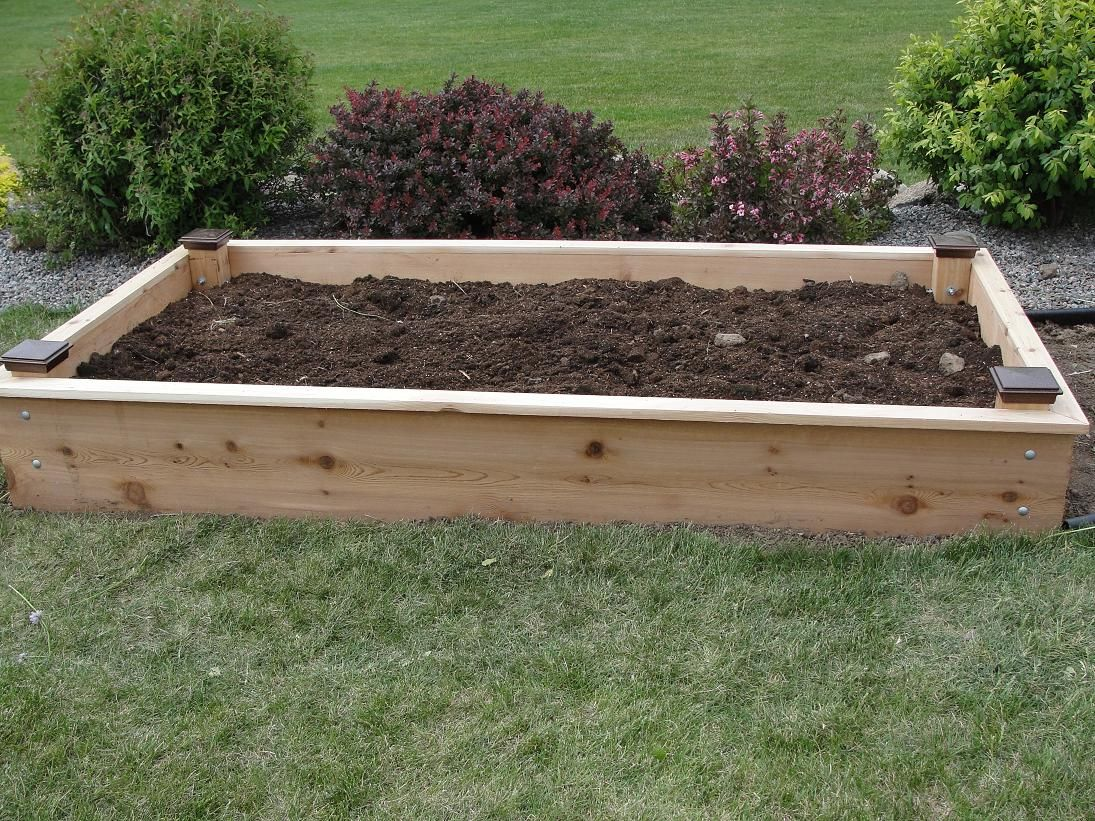 inexpensive but handsome raised bed the finials are a. Black Bedroom Furniture Sets. Home Design Ideas