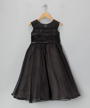 Dainty darlings with a winsome sense of style will love this twirl-perfect frock. Designed with layer upon layer of gauzy chiffon, semi sheer shoulders and a tie in the back, it's sure to look smashing at any fine affair.